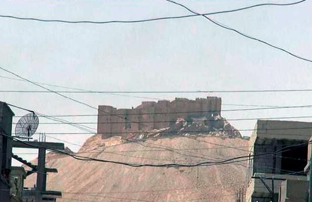This picture released on Thursday, May 21, 2015 by the website of Islamic State militants, shows the Palmyra castle is seen from the Syrian town of Palmyra that was captured by the Islamic State militants after a battle with the Syrian government forces, Syria. (The website of Islamic State militants via AP)