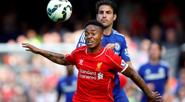 Chelsea's Cesc Fabregas in action with Liverpool's Raheem Sterling