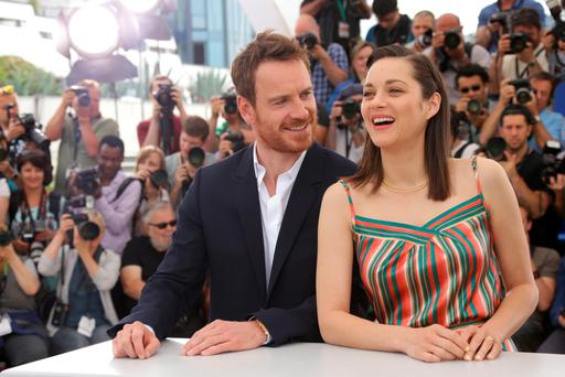 Michael Fassbender and Marion Cotillard pose for photographers during a photo call for the film Macbeth, at the 68th international film festival, Cannes, southern France, Saturday, May 23, 2015. (Photo by Joel Ryan/Invision/AP)