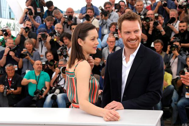 Michael Fassbender, right, and Marion Cotillard pose for photographers during a photo call for the film Macbeth, at the 68th international film festival, Cannes, southern France, Saturday, May 23, 2015. (Photo by Joel Ryan/Invision/AP)