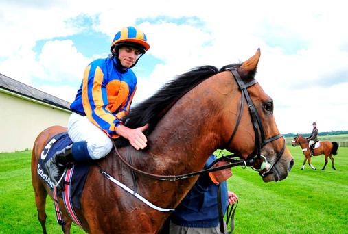 Ryan Moore on Gleneagles after winning the Tattersalls Irish 2,000 Guineas during the Tattersalls Irish Guineas Festival at The Curragh Racecourse