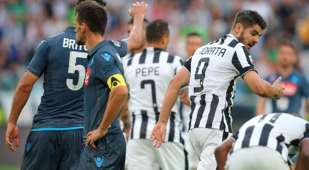 Juventus' forward from Spain Alvaro Morata (R) argues with Napoli's defender from Uruguay Miguel Britos (L) who received a red card