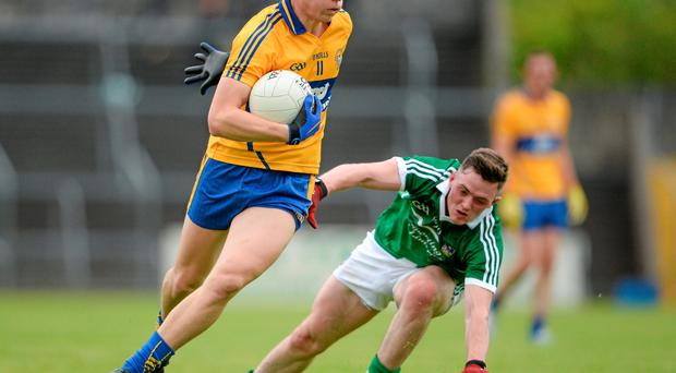 23 May 2015; Jamie Malone, Clare, gets away from Stephen Cahill, Limerick. Munster GAA Football Senior Championship Quarter-Final, Clare v Limerick, Cusack Park, Ennis, Co. Clare. Picture credit: Brendan Moran / SPORTSFILE