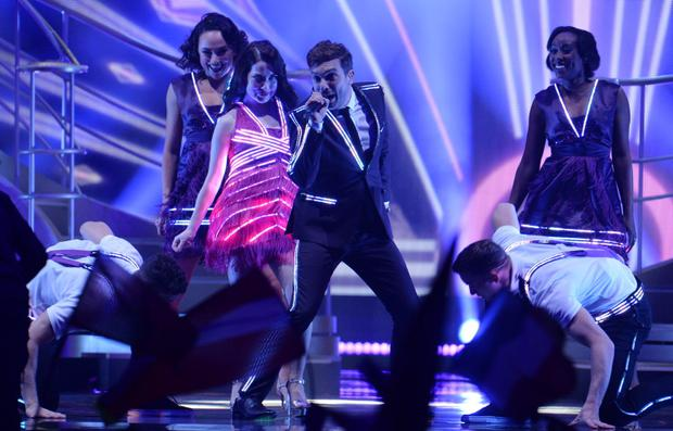 Electro Velvet representing United Kingdom perform the song 'Still In Love With You' during the final of the Eurovision Song Contest in Austria's capital Vienna, Saturday, May 23, 2015. (AP Photo/Kerstin Joensson)