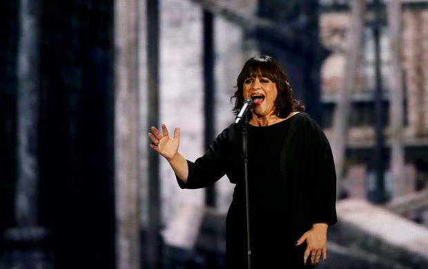 Singer Lisa Angell of France performs the song