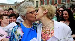 LOVE IS IN THE AIR: Senator Katherine Zappone, left, kisses her partner Ann Louise Gilligan after the proposal at Dublin Castle