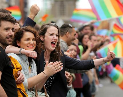 People celebrate the Yes vote on the streets outside Dublin Castle. Picture; GERRY MOONEY. 23/5/15