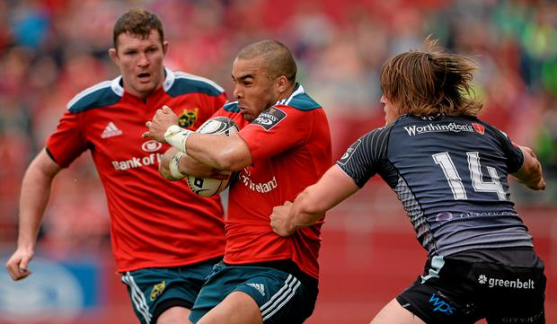 Munster's Simon Zebo is tackled by Jeff Hassler of Ospreys