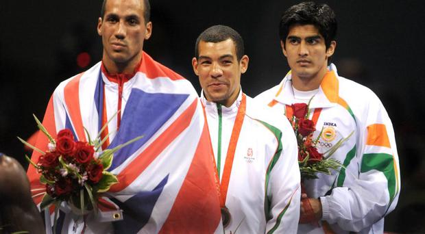 James DeGale (front) receiving his Olympic gold, Darren Sutherland (centre) won bronze in Beijing