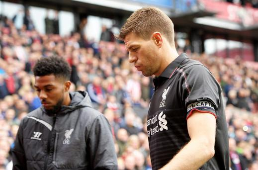 Liverpool's Steven Gerrard walks off looking dejected at half time Action Images via Reuters / Paul Burrows Livepic
