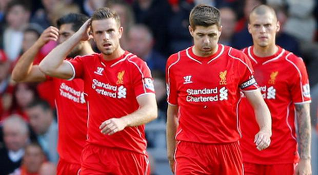 Liverpool's Jordan Henderson and Steven Gerrard look dejected