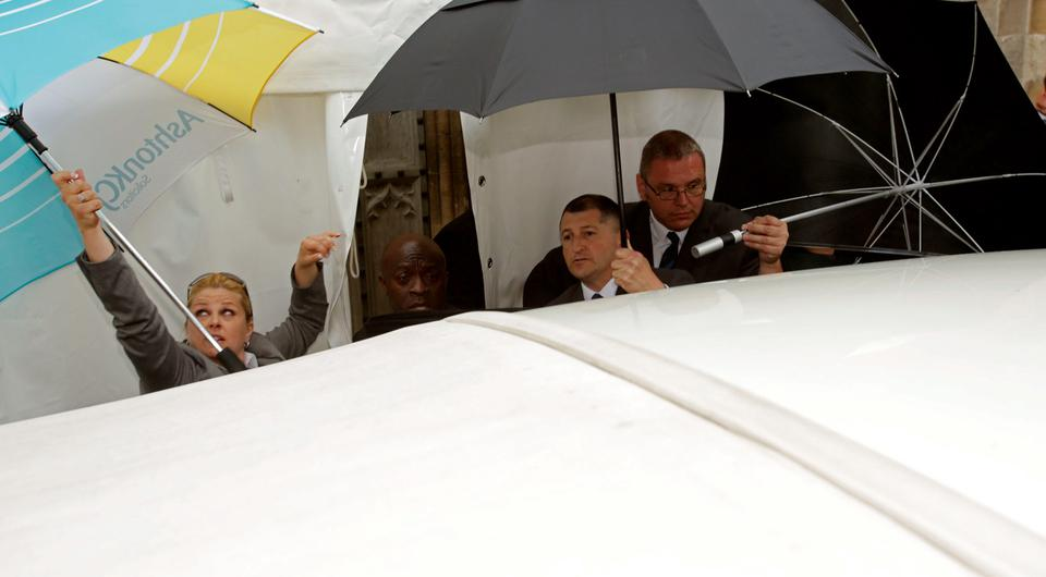 Security guards use umbrellas to block the view of former Coronation Street actress Michelle Keegan as she arrivies at St Mary's Church in Bury St Edmonds, Suffolk, for her wedding to The Only Way Is Essex star Mark Wright. Yui Mok/PA Wire