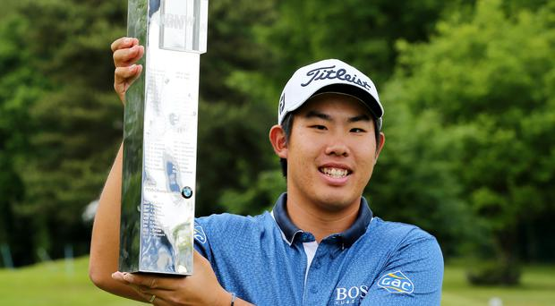 South Korea's Byeong Hun An celebrates with the trophy after winning the BMW PGA Championship Action Images via Reuters / Paul Childs