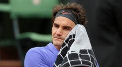 Switzerland's Roger Federer wipes his face during a break