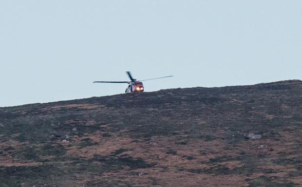 Sunday 24 May 2015. A helicopter lands near the site of plane crash near Ballymurphy, Co. Carlow. This part of the mountain is known locally as Walshtown.