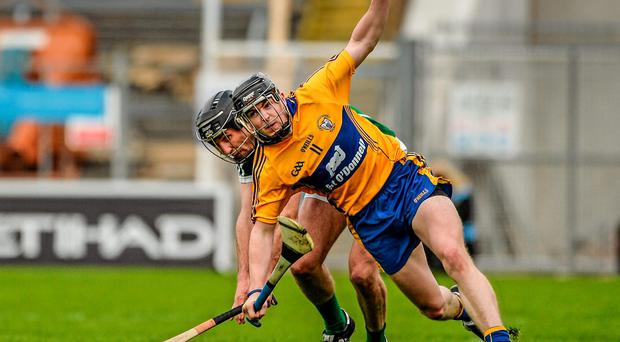 Clare's Tony Kelly attempts to break free from the attentions of Limerick's Donal O'Grady during yesterday's Munster SHC quarter-final at Semple Stadium