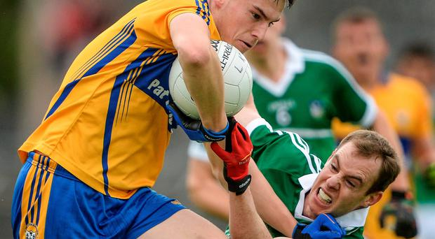 Jamie Malone of Clare brushes aside Limerick's Seanie Buckley during their Munster SFC quarter-final