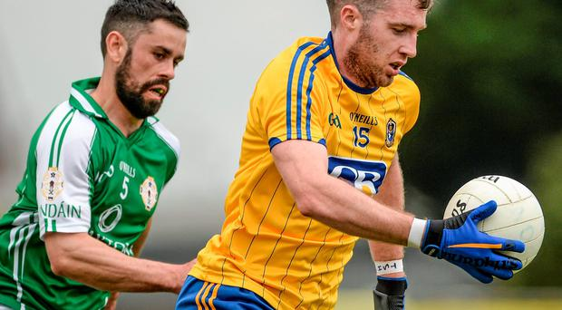 Roscommon's Cathal Cregg in action against Donnacha McCarthy of London during their Connacht SFC quarter-final