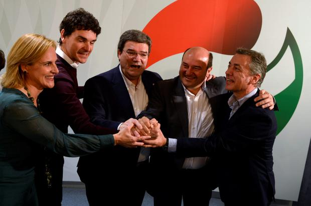 (L-R) Itxaso Atutxa, Unai Rementeria, Juan Mari Aburto, Andoni Ortuzar and Inigo Urkullu of the Basque Nationalist Party (PNV) celebrate results in local and municipal elections in Bilbao, Spain, May 24, 2015. REUTERS/Vincent West
