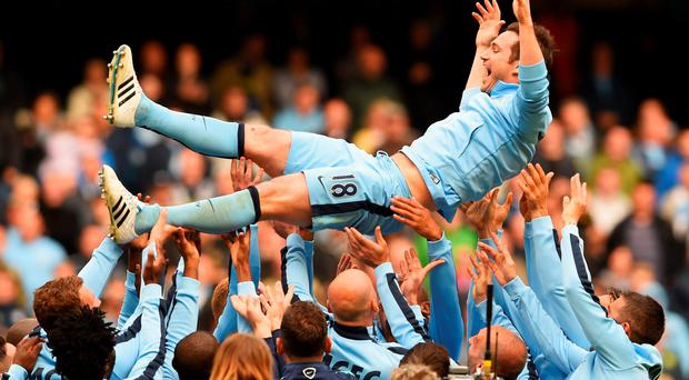 Frank Lampard is thrown into the air by his Manchester City team-mates