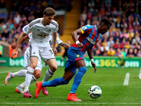 Crystal Palace's Wilfried Zaha in action during the match at Selhurst Park