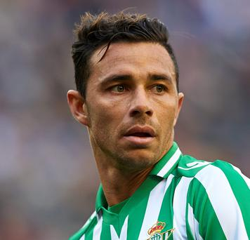 Real Betis' Ruben Castro scored twice in their 3-0 victory over Alcorcon which secured their return to Spain's first division