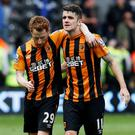 Hull City's Irish internationals Stephen Quinn and Robbie Brady look dejected at the end of yesterday's scoreless draw with Manchester United