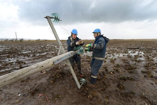 ESB crew Michael Stack and Denny Walsh from Tralee working in North Kerry after last year's storms