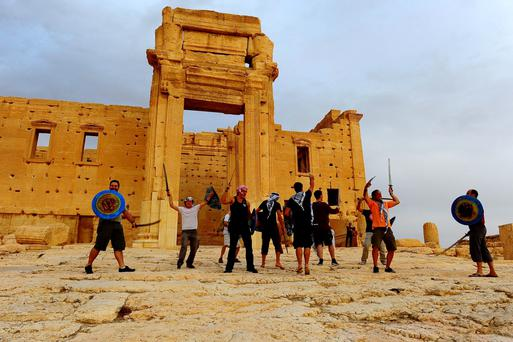 A group of tourists dance in front of the Temple of Bel at the historical city of Palmyra October 22, 2010. REUTERS/Omar Sanadiki
