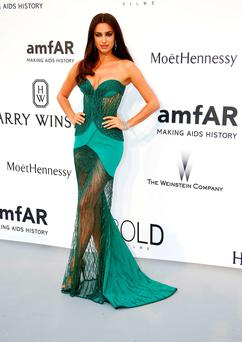 Russian model Irina Shayk poses as she arrives for the amfAR 22st Annual Cinema Against AIDS during the 68th Cannes Film Festival