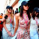 (L-R) Gigi Hadid, Kendall Jenner and Bella Hadid make their way to the grid during the Monaco Formula One Grand Prix at Circuit de Monaco on May 24, 2015 in Monte-Carlo, Monaco. (Photo by Mark Thompson/Getty Images)