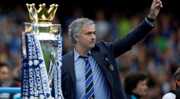 Chelsea's Portuguese manager Jose Mourinho gestures during the presentation of the Premier League trophy at Stamford Bridge at the weekend.