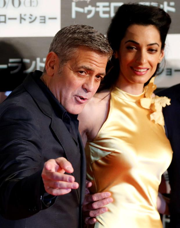 Cast member George Clooney (left) poses with his wife Amal on the red carpet during the Japan premiere of the movie