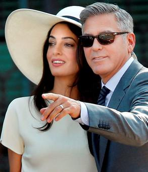 Beauty and brains: Did George Clooney marry Amal because she's gorgeous or because she's smart? (AP Photo/Luca Bruno).