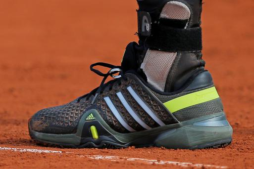 Andy Murray's wedding ring attached to his shoe as he plays Facundo Arguello at Roland Garros yesterday