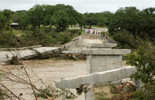 The Fischer Store Road bridge over the Blanco River near Wimberley, Texas is destroyed after a flood on Sunday. (Jay Janner/Austin American-Statesman via AP)