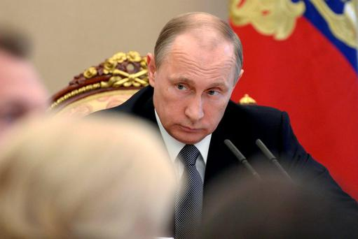 Russian President Vladimir Putin chairs a meeting with members of the government at the Kremlin. Photo: Reuters
