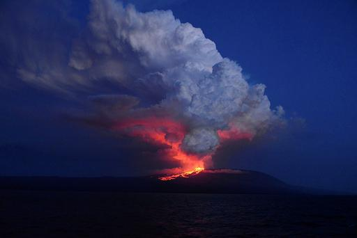 The Wolf volcano spews smoke and lava on Isabela Island Credit: Diego Paredes (Galapagos National ParK)