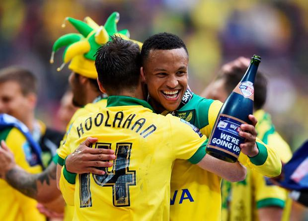 Wes Hoolahan (14) and Martin Olsson celebrate victory after the Sky Bet Championship Playoff Final between Middlesbrough and Norwich City at Wembley Stadium