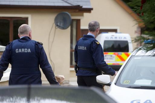 Gardai at the house at Laragh at the centre of a robbery last night.