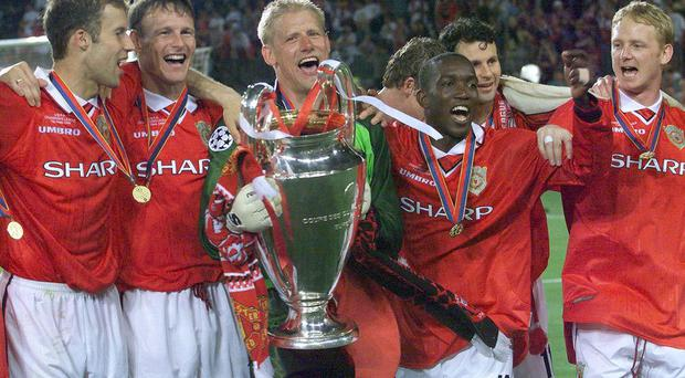 Manchester United players celebrate the 1999 Champions League final victory over Bayern Munich