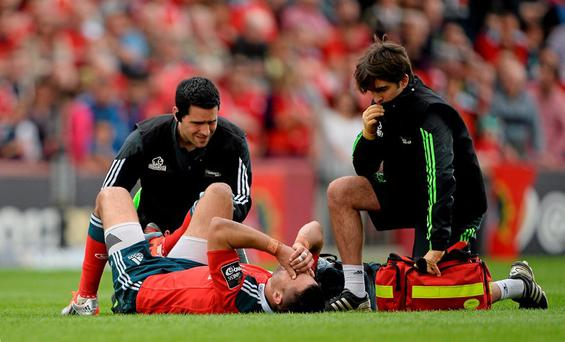 Munster's Conor Murray is attended to by medical staff for a suspected knee in the victory over the Ospreys