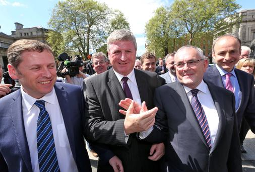 Fianna Fail leader, Micheal Martin with Newly elected Fianna Fail TD for Carlow Kilkenny, Deputy Bobby Aylward (wearing purple tie) pictured arriving at Leinster House this afternoon with members of the Fianna Fail Party. Picture Colin Keegan, Collins Dublin.