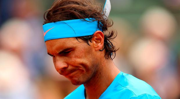 Rafael Nadal of Spain reflects during his Men's Singles match against Quentin Halys of France on day three of the 2015 French Open at Roland Garros
