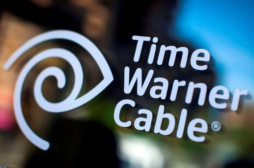 A Time Warner Cable sign and logo are seen on a Time Warner Cable store in the Manhattan borough of New York City, May 26, 2015. Charter Communications Inc, controlled by cable industry pioneer John Malone, offered to buy Time Warner Cable Inc for $56 billion, seeking to combine the No. 3 and No. 2 U.S. cable operators to compete against market leader Comcast Corp. REUTERS/Mike Segar