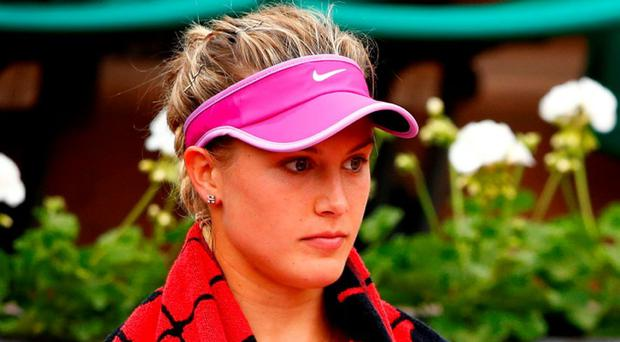Eugenie Bouchard of Canada reacts during her women's singles match against Kristina Mladenovic of France