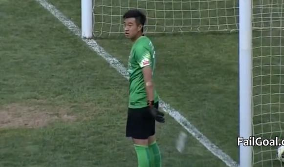 Sui Weijie stands bemused after the ball hits the net