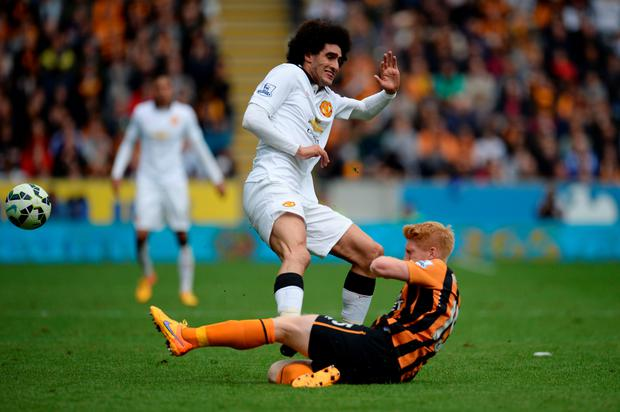Marouane Fellaini received a red card for this tackle on Ireland defender Paul McShane in the final Premier League game of last season.