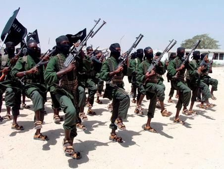 Hundreds of newly trained al-Shabab fighters perform military exercises in the Lafofe area some 18km south of Mogadishu, in Somalia. Photo: AP