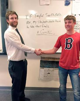 Teacher Colter Pierce shakes hands with Ike Stoner on the deal